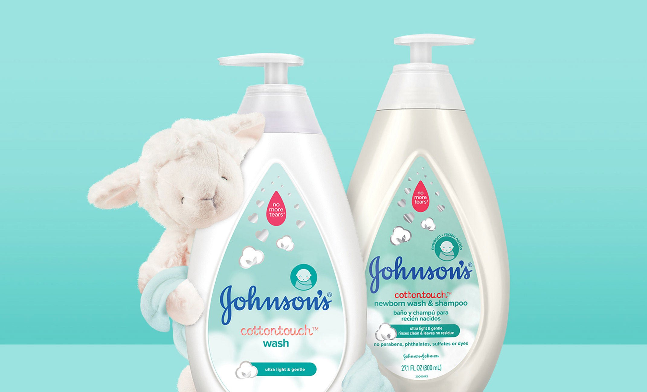 Johnson's® CottonTouch™ newborn products next to a sheep stuffed animal